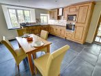 The kitchen diner has smart fitted units and a contemporary dining table and chairs