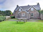 The School House is an attractive stone cottage with original features and an enclosed lawned garden