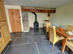 The large kitchen/diner has fitted oak units, a woodburning stove in the inglenook and a beautiful slate floor