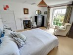 Plenty of room in the bedroom, contains a king size bed and features its own original fire place