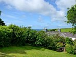 The view from the garden is of the surrounding area and coast line