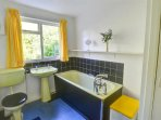 This property also has a bath, yellow and black themed furnishings