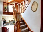 The staircase form the sitting room, leading up to the first floor with hand banisters