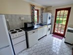 The separate utility room has an electric cooker, microwave, dishwasher, washing machine, tumble dryer, sink and a...