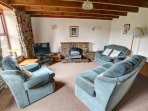 Sitting room with beamed ceiling and some original stone walling