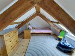 Galleried single bedroom with sloping ceilings, suitable for a child