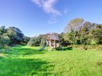 The extensive shared grounds include this exciting playhouse