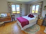 Spacious double bedroom with views of the lovely countryside