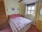 Comfy looking double bed, with fitted wardrobe and bedside cabinets
