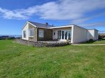 1 Little West Bungalows stands in extensive grounds overlooking the sea at Southerndown