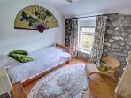 This second single room has a stone wall and interesting finishing touches