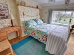 Charming double bedroom furnished in keeping with its character