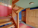 The vibrant nature of this cottage continues through the hallway and stairs