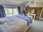 Attractive double bedroom with some stone walling to add to its character