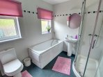 Clean, bright bathroom with separate shower cubicle