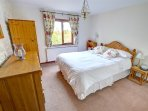 The lovely ground floor bedroom is furnished in pine and has a double bed