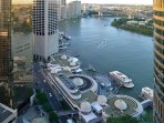Spectacular view of the Story Bridge, Brisbane River, Eagle Street Pier and the city from balcony