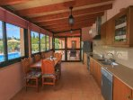 Outdoor equipped kitchen and dining area