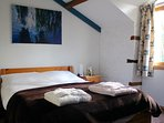 Double bed upstairs with luxury cotton bed linen