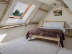 Lovely light bedroom on second floor, with great views over the town
