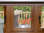 View to the deck from the kitchen. Guests tell us the window makes a handy serving hatch for BBQs!