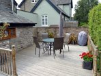 Private deck area with seating for four, parasol and BBQ