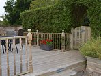 Deck leads to gated and fenced grass area ideal for dogs