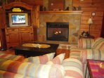 Enjoy this cozy GREAT ROOM with easy-on gas fireplace and TV with DVD/VHS player