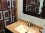 Hall Bathroom; remodeled April 2017. New vanities with solid surface and under-mounted sink
