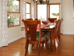 This dining room seats 6 comfortably with direct access to the deck, BBQ, and an additional 6 seats.