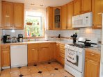 This fully stocked kitchen has all the amenities that you would find in one of the finest hotels.