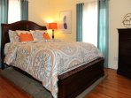 The upstairs guest BR offers a Queen size bed, mirrored closet, ceiling fan, and chest of drawers.