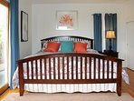 This King size master bedroom is spacious offering access to the deck. Listen for the surf and seals