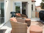Very spacious deck will accommodate many guests.  We have chaise loungers for sun bathing in privacy
