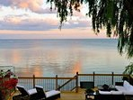 Backyard Paradise. Relax with a glass of wine and enjoy the spectacular serenity of the water view.