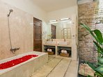 Ensuite bathroom with bathtub, double wash basin and outdoor shower