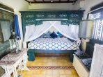 Cosy Cottage interior. Antique four poster bed