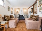 leaving room with 2 sofa bed, TV, fire place/ barbecu