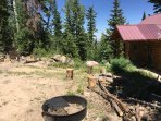 Main (upper) driveway to cabin.  Firepit(s) and grates on-site
