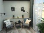 Reading zone at glassed balcony, fold-able windows, extra sleep.