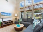 Kick back and relax at Ohana Kai, where you have a large, family-size couch, beautiful wood flooring, full air...