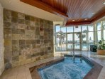 Indoor hot tub overlooking the pool and gulf