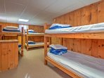 3 sets of twin-over-twin bunk beds are in the 3rd bedroom