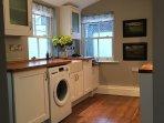Kitchen - oven, gas hob, fridge, freezer, washing machine, dishwasher, microwave.