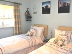 The twin bedroom is again spacious and light complete with wall mounted TV/DVD player