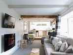 The  open plan living space is light and bright with a great neww sofa to curl up on after a day out