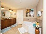 Double vanity, granite counter tops, walk-in shower and garden tub.