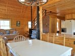 Open Concept living space combines living room, loft area, kitchen, and dining