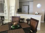 Dining accommodates up to six in dining room and counter bar area.