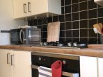 Fully equipped kitchen with washing machine, stove,hob,oven,fridge/freezer